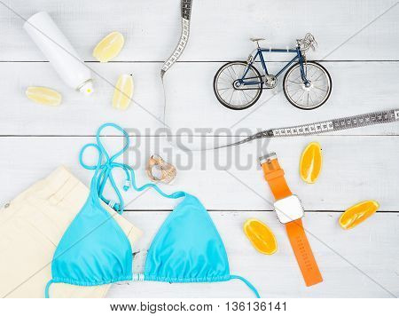 Bicycle Model, Blue Swimsuit, Yellow Shorts, Smart Watch, Sunscreen, Centimeter Tape, Lemon And Oran