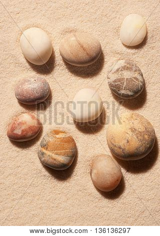 Collection Of Sea Stones On Sand. Summer Beach Background