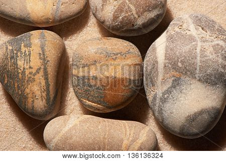 Close Up Of Sea Stones On Sand. Summer Beach Background