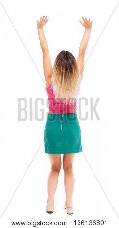 Back view of beautiful woman welcomes. Young teenager girl in jeans hand waving from. Rear view people collection. backside view person. Blond girl in green skirt holding of severity