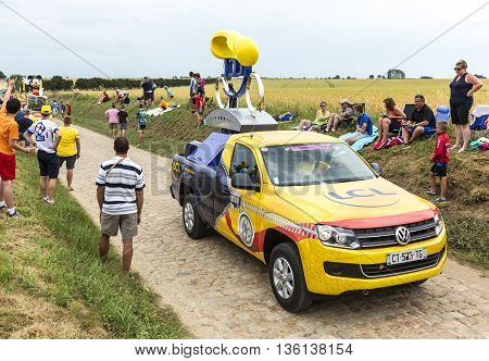 Quievy, France - July 07 2015: LCL vehicle during the passing of the Publicity Caravan on a cobblestoned road in the stage 4 of Le Tour de France on July 7 2015 in Quievy France.