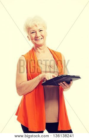 An old lady with tablet.