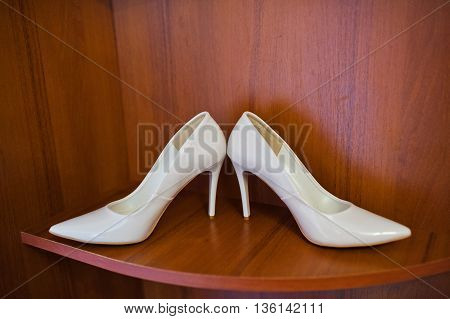 White Wedding Shoes Of Bride On Wooden Background