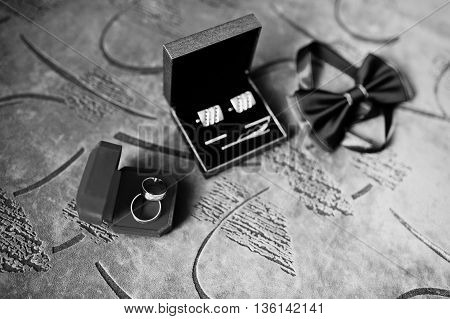 Set Of Groom Clothes. Wedding Rings,  Cufflinks And Bow Tie