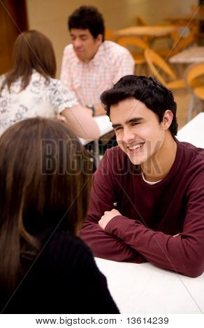 couple looking happy and relaxed talking in a restaurant