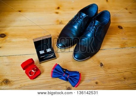 Set Of Groom Clothes. Wedding Rings, Shoes, Cufflinks And Bow Tie