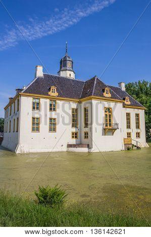 SLOCHTEREN, NETHERLANDS - JUNE 3, 2016: Old dutch mansion Fraeylemaborg in Slochteren, Holland