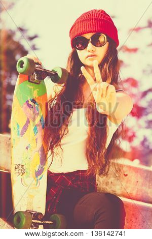 Skater girl doing peace sign