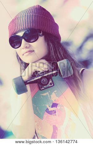 Skater girl wearing glasses and beanie