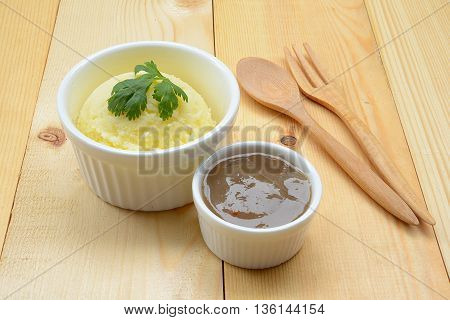 Close up of mashed potatoes with  gravy