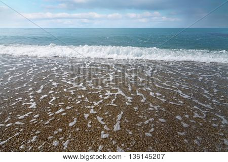 calm waves at the beach / hot summer day photo Crimea