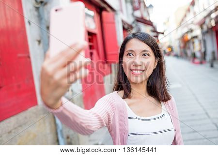 Asian woman use of cellphone to take photo
