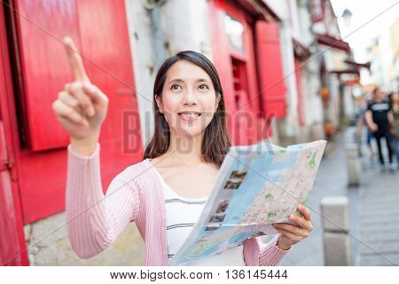 Woman finding destination on city map