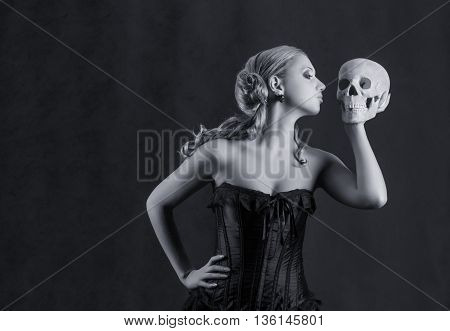 Woman with a skull Studio shot Black and white