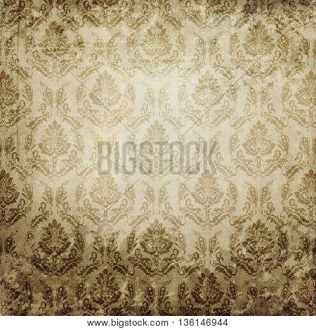 Aging paper background with decorative old-fashioned patterns. Vintage paper texture for the design.