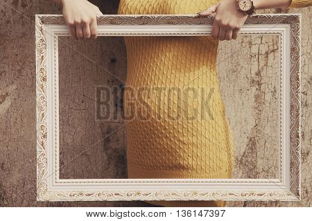 pregnant woman's belly in the white frame