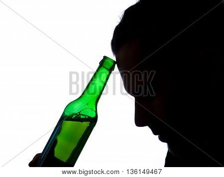Silhouette of aman with a bottle of beer