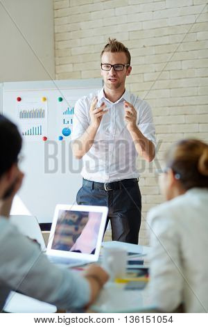 Businessman explaining business ideas to his colleagues