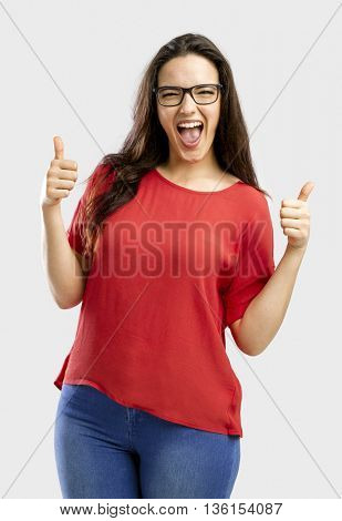 Beautiful and happy woman with thumbs up, isolated over white background