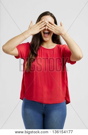 Lovey woman covering her eyes with hands