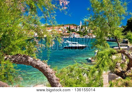 Turquoise beach of Ugljan island and town of Kali view Dalmatia Croatia