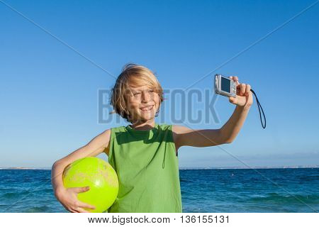 happy kid on summer holiday taking selfie photo in Mallorca