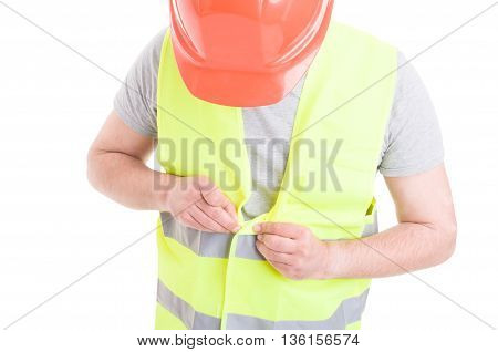 Male Constructor With Helmet And Vest Gets Ready For Work