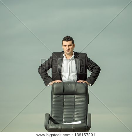 Businessman With Paper On Chair Outdoor