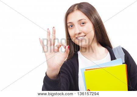 Happy student girl showing Ok sign, isolated on white background