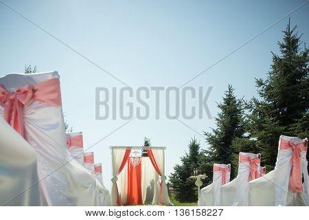 Beautiful arrangement for wedding ceremony outdoor on blue sky background