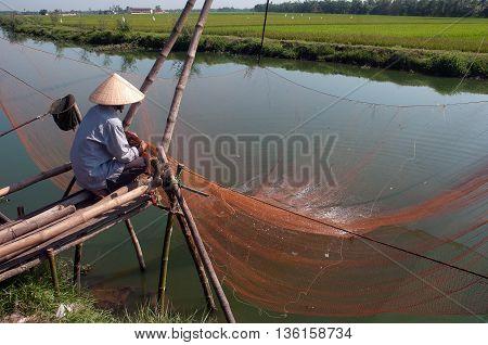Hue, Vietnam, May 12, 2016 man, fishing nets, the Tam Giang Lagoon, Hue, Vietnam