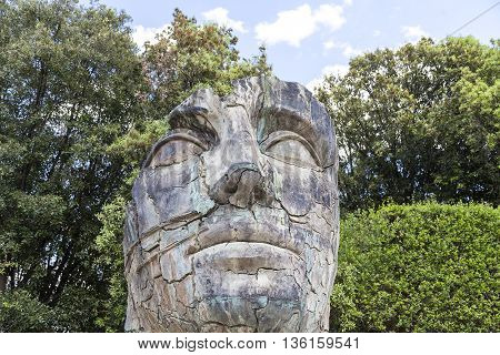 FLORENCE ITALY - MAY 18 2014 : Sculpture by Igor Mitoraj in the Boboli Gardens in Florence Italy. Works of Polish sculptor Igor Mitoraj often gigantic size stand in representative sections of many cities in the world.