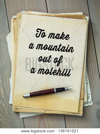 Traditional English proverb.  To make a mountain out of a molehill