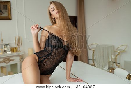 Elegant sexy blonde woman posing in lingerie. Studio shot. Great ass. Very hot.