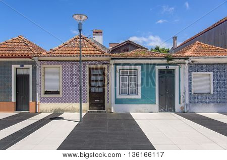 Typical small houses decorated with traditional tiles in the city of Aveiro, Portugal.