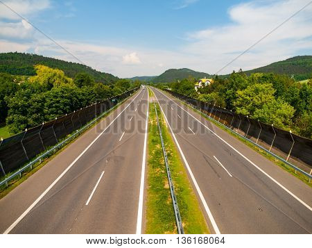 Empty highway withe no cars on sunny summer day