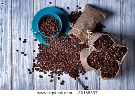 Jute Bags With Coffee Beans And Blue Cup.