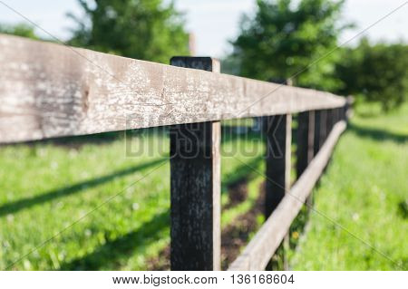 Old fence fragment outdoor selective focus closeup