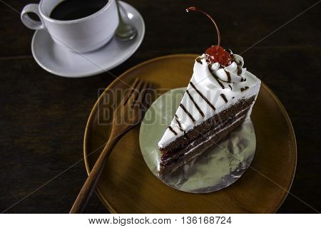 Slice of chocolate layer cake with berries and chocolate sauce