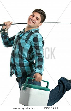 Happy Fisherman With His Rod And Cooler