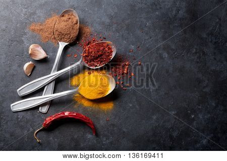 Colorful spices in spoons. Top view with copy space