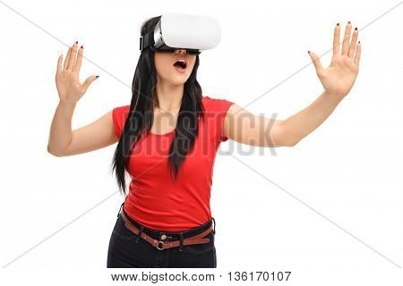 Amazed girl experiencing virtual reality via VR goggles isolated on white background