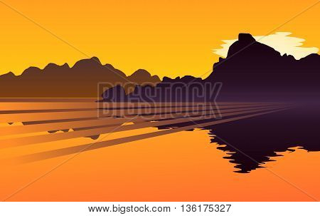 Sunset over a mountain lake, with a little bit of cloud