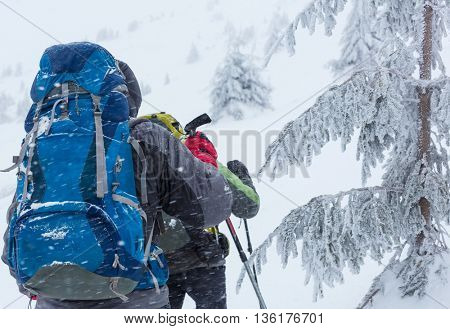 Hiker with snowshoes in winter