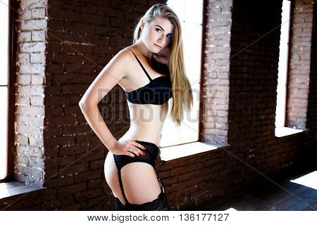 Sexy young woman wearing black lingerie with bra and panties