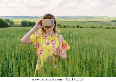 Young Woman Looking Into A Virtual Reality Glasses