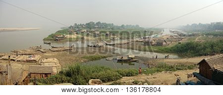 Slum village near the river in the Mandalay city in Myanmar Burma