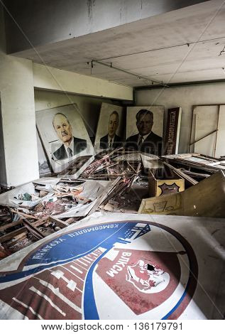 Pripyat, Ukraine - May 29, 2016: abandoned school room with pictures and debris on the floor in Pripyat, Chernobyl, Ukraine