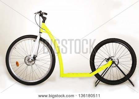 Big kick-bike (scooter) on a white background