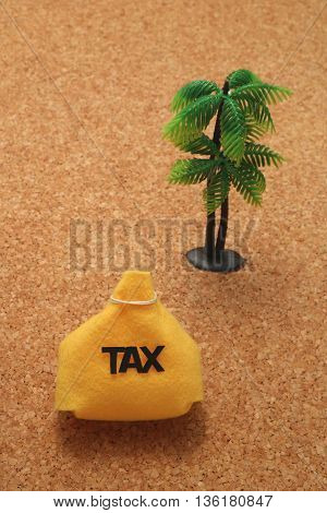 Tax and miniature palm trees on cork board.